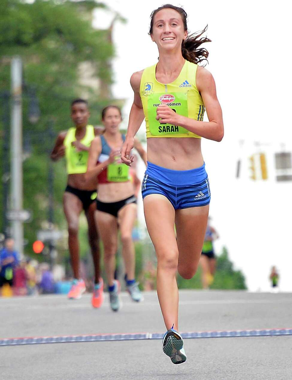 #10 Sarah Pagano of Brighton, Mass., pulls ahead of @2 Diane Nukuri, left, and #8 Stephanie Bruce to win the 40th anniversary of the Freihofer's Run For Women Saturday June 2, 2018 in Albany, NY. (John Carl D'Annibale/Times Union)