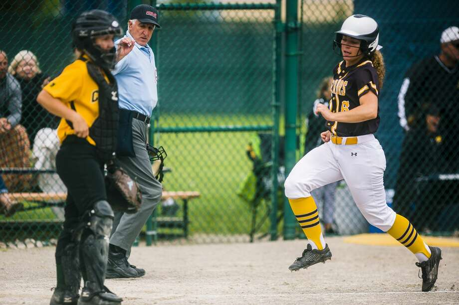 Bay City Western senior Olivia Kowalski runs toward home plate to score a run during the Warriors' District 2 semifinals game against Dow on Saturday, June 2, 2018 at Mt. Pleasant High School. (Katy Kildee/kkildee@mdn.net) Photo: (Katy Kildee/kkildee@mdn.net)