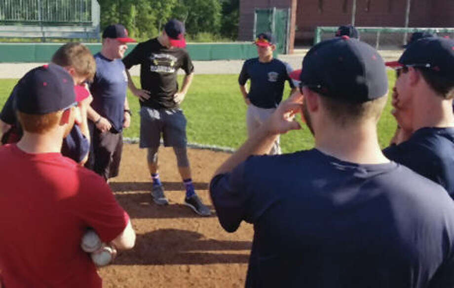 Head coach Nick Paulda (left) addresses his Alton Post 126 senior legion baseball team during a preseason practice. Post 126, which is fielding its first senior legion team since 2013, opens the season Sunday against Breese at Alton High in Godfrey.