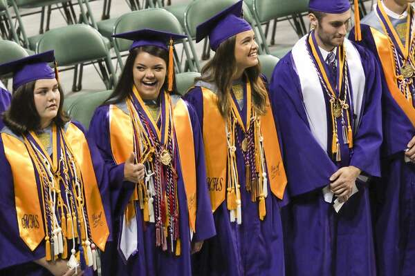 Midland High seniors process in during commencement ceremonies 06/02/18 morning at the Chaparral Center. Tim Fischer/Reporter-Telegram
