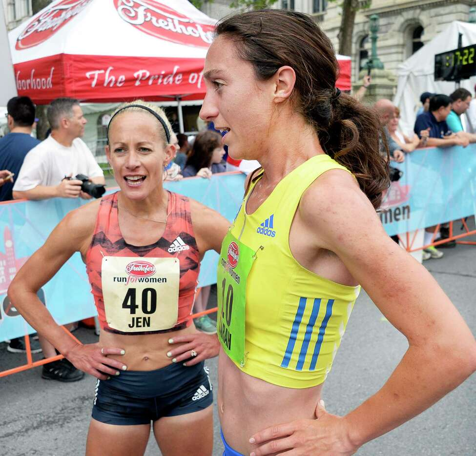Race winner #10 Sarah Pagano, right, and Masters top finisher #40 Jen Rhines chat after finishing the 40th anniversary Freihofer's Run For Women Saturday June 2, 2018 in Albany, NY. (John Carl D'Annibale/Times Union)
