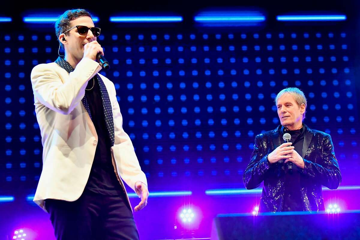 SAN FRANCISCO, CA - JUNE 01: Andy Samberg and Michael Bolton perform with The Lonely Island on the Colossal Stage during Clusterfest at Civic Center Plaza and The Bill Graham Civic Auditorium on June 1, 2018 in San Francisco, California. (Photo by Jeff Kravitz/FilmMagic)
