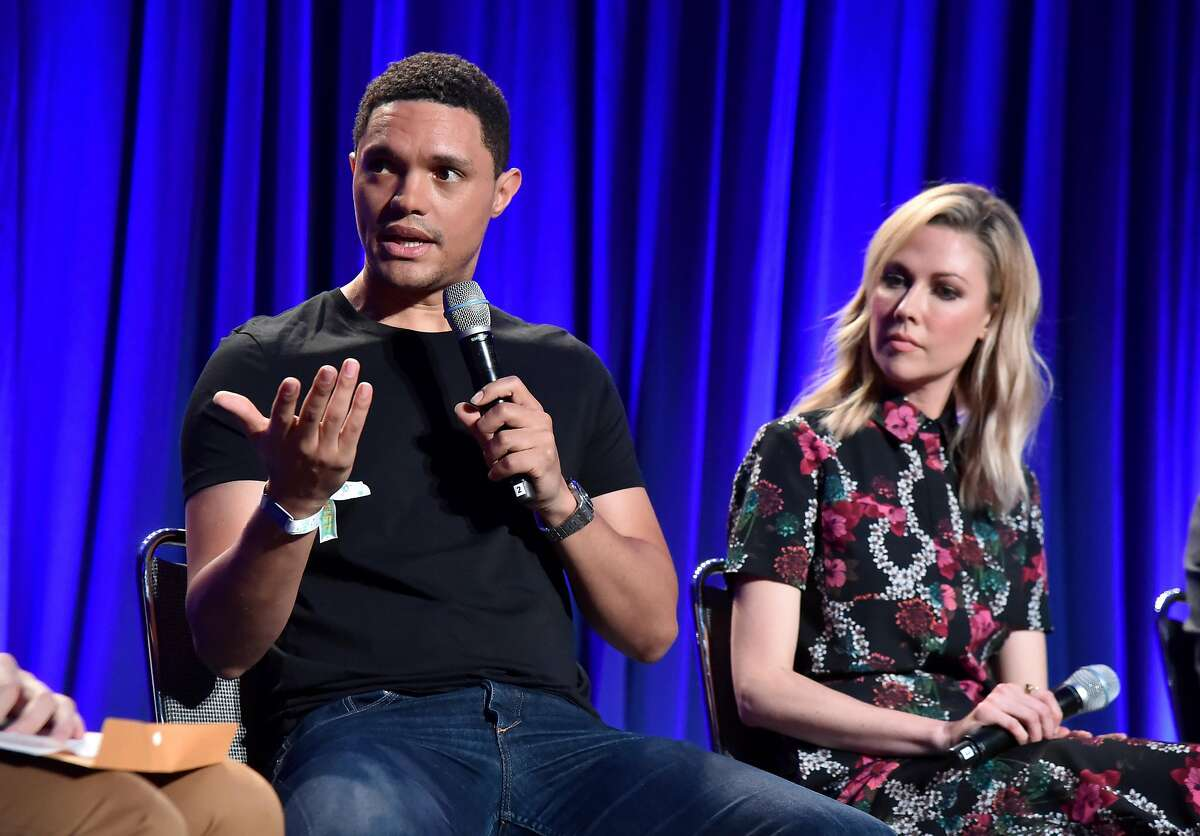SAN FRANCISCO, CA - JUNE 01: Trevor Noah (L) and Desi Lydic speak onstage during 'The Daily Show Live: A Conversation with Trevor Noah and The World's Fakest News Team' in the Larkin Comedy Club during Clusterfest at Civic Center Plaza and The Bill Graham Civic Auditorium on June 1, 2018 in San Francisco, California. (Photo by Jeff Kravitz/FilmMagic)