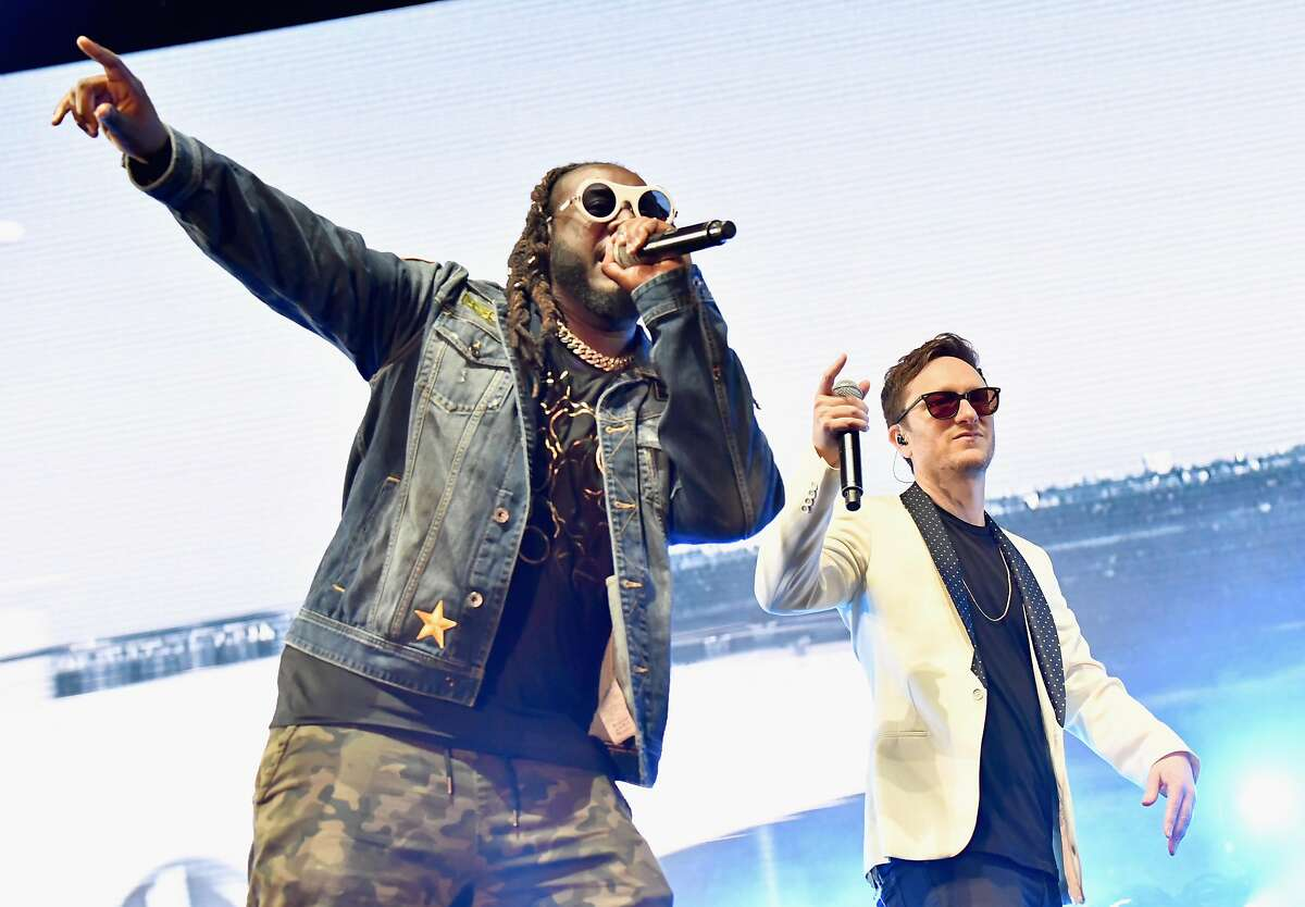 Akiva Shaffer (R) of The Lonely Island and T-Pain perform on the Colossal Stage during Clusterfest at Civic Center Plaza and The Bill Graham Civic Auditorium on June 1, 2018 in San Francisco, California.