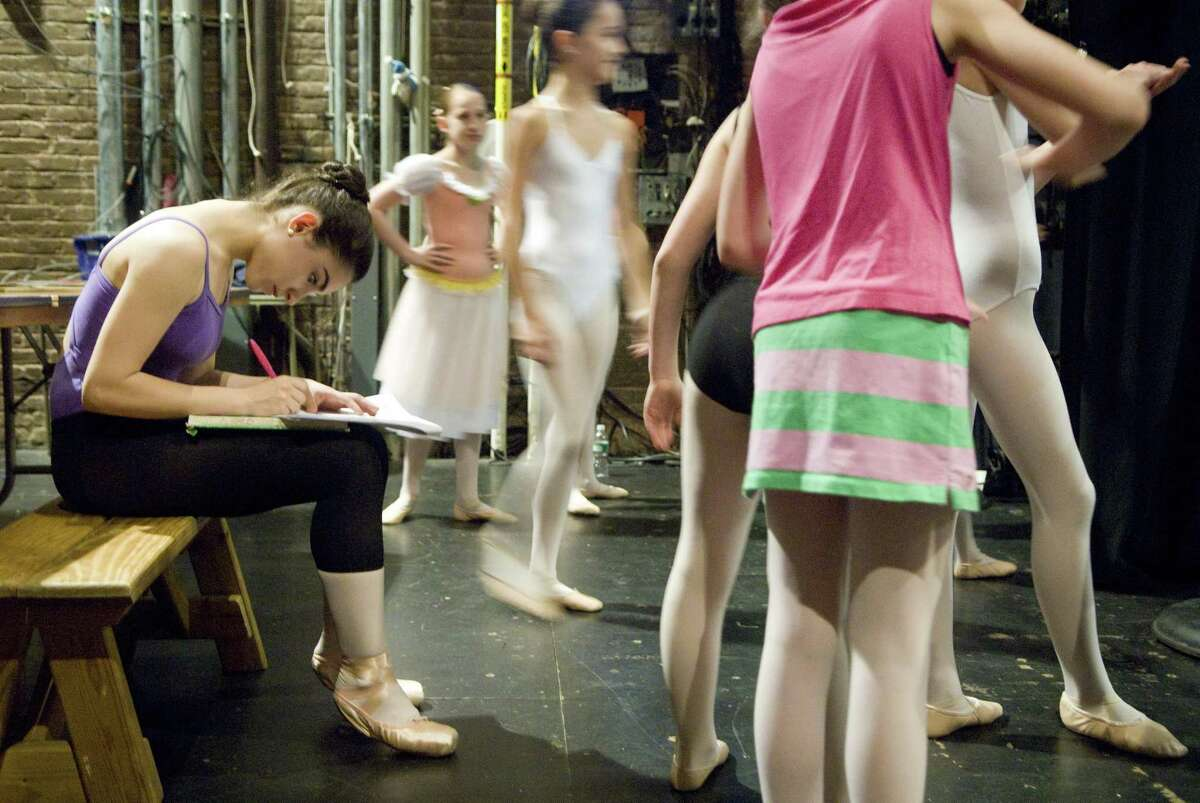 Marielle Martiney, 15, of Stamford, takes a moment to prepare for her Spanish final backstage during a rehearsal of the Ballet School of Stamford's production of Coppelia on Wednesday, June 4, 2008.