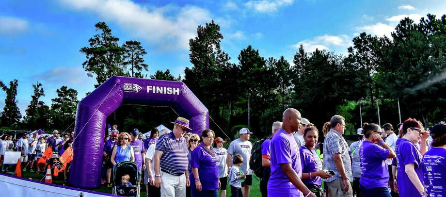 Participants cross the finish line of the 5k 2017 Walk to End Alzheimer's in North Harris County-Montgomery County. Photo: Contributed Photo / Alzheimer's Association