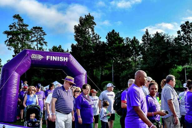 Participants cross the finish line of the 5k 2017 Walk to End Alzheimer's in North Harris County-Montgomery County.