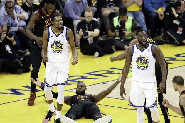 Warriors forward Kevin Durant (35) reacts to a call while standing over Cavaliers forward LeBron James during Game 1 of the NBA Finals on Thursday.