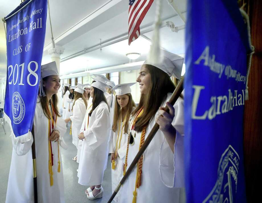 Milford,  Connecticut - June 2, 2018: Lauralton Hall  Salutatorian Lily Wald of Derby, left, and Valedictorian Caroline Favano of Norwalk right, hold on to Lauralton Hall banners as the wait to lead the  Lauralton Hall Class of 2018 Graduation processional Saturday at Lauralton Hall in Milford. Photo: Peter Hvizdak / Hearst Connecticut Media / New Haven Register