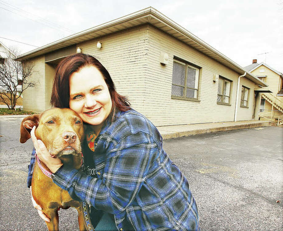 Alicia Jeffreys, owner of Shampooches Dog Grooming LLC, with one of her canine friends in front of her business located at 1735 Main St. in Alton. Photo:       John Badman|The Telegraph