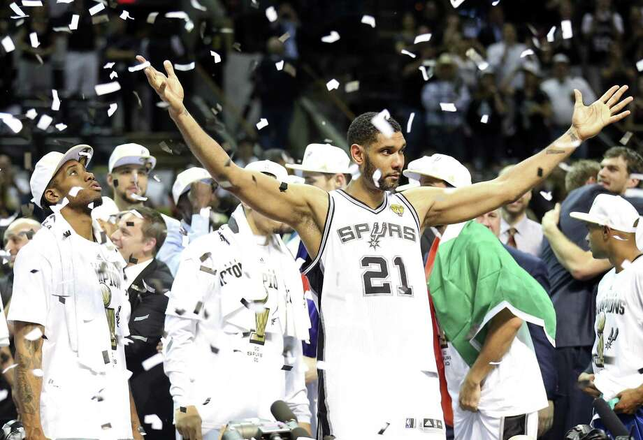 San Antonio Spurs' Kawhi Leonard, Tim Duncan and teammates react after Game 5 of the 2014 NBA Finals against the Miami Heat Sunday June 15, 2014 at the AT&T Center. The Spurs won 104-87. Photo: Edward A. Ornelas, Staff / San Antonio Express-News / © 2014 San Antonio Express-News
