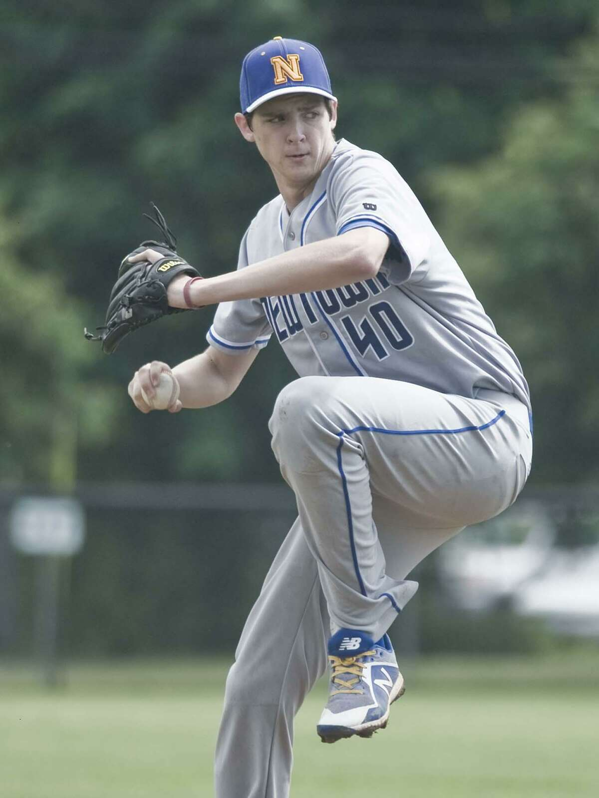 Newtown High School pitcher Kyle Roche delivers the ball in the Class LL quarterfinal baseball game against Ridgefield High School, played at Ridgefield. Saturday, June 2, 2018