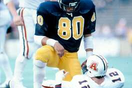 California Golden Bear Ron Rivera sacks Arizona Quarterback Tom Tunnicliffe in 1983.  Rivera is now the Head Coach of the Carolina Panthers, who the San Francisco 49ers will face in the 2014 NFL Divisional Playoff Round on Sunday, January 12, 2014, in Carolina.