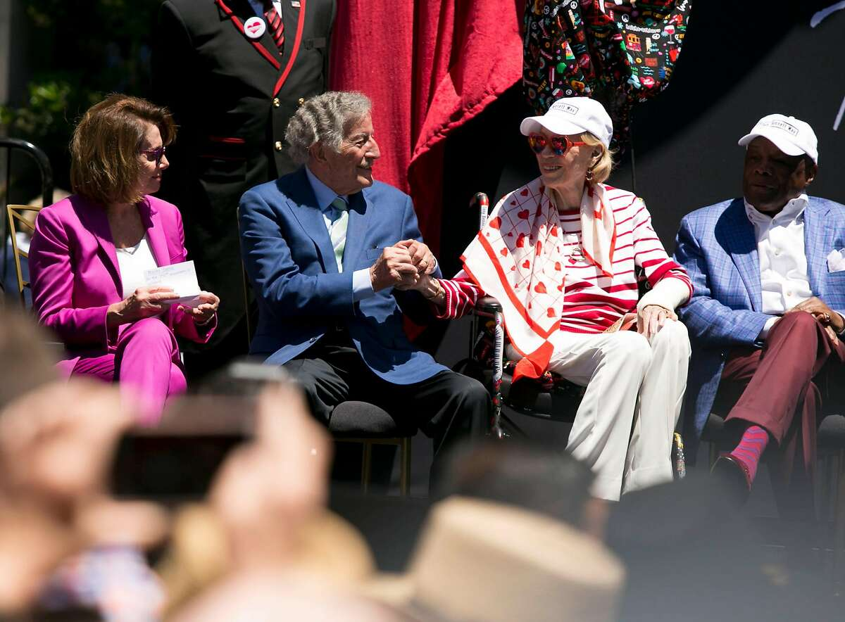 """Tony Bennett, center, holds hands with Charlotte Schultz, Chief of Protocol for the City and County of San Francisco. The city of San Francisco honored singer Tony Bennett by naming the section on Mason Street in front of the Fairmont Hotel between California and Sacramento """"Tony Bennett Way"""" Saturday June 2, 2018 on Nob Hill in San Francisco."""