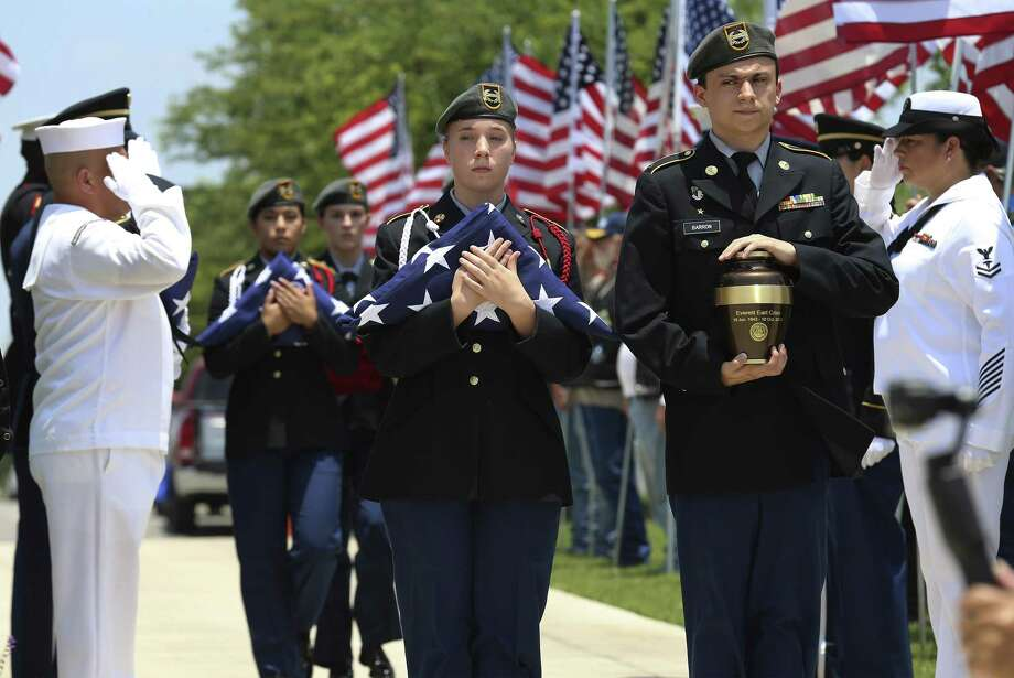MacArthur Junior ROTC students Michael Barron (right) and Grace Conger carry the cremated remains of veteran Everett Earl Criss as Fort Sam Houston National Cemetery and the Missing In America Project conduct a military burial service for the cremated remains of eight unclaimed veterans on Friday, June 1, 2018. The cremains of the  veterans were escorted by the Patriot Guard motorcycle group to the Fort Sam Houston National Cemetery where the Fort Sam Houston Memorial Services Detachment provided Honors and Taps. MacArthur High School JROTC students served as Honoree Color Guard. The Missing in America Project is a non-profit organization launched nationwide in 2007 with the mission of locatiing, identifying and interring the unclaimed cremains of Americaís veterans. MIAP identified the deceased veterans on Friday's ceremony. Three of the deceased veterans were from the U.S. Army, one from the Marine Corps, three from the Navy and one Veteran who served in three branches of the  service - Air Force, Navy and Army - with combined service in the Cold War, Korean and Vietnam War periods. The cremated remains will be interred at Fort Sam Houston National Cemetery. (Kin Man Hui/San Antonio Express-News) Photo: Kin Man Hui, Staff / San Antonio Express-News / ©2018 San Antonio Express-News