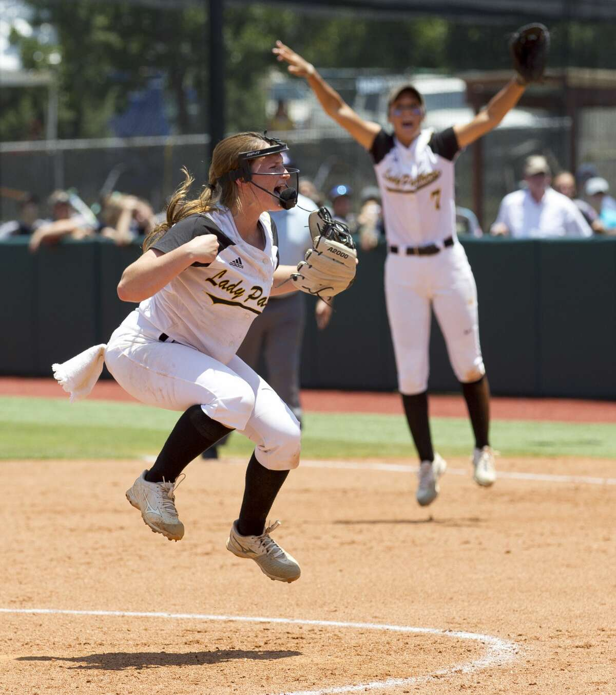 Liberty starting pitcher Kaci West (9) reacts in front of first baseman Harley Davis after defeating Vernon 3-1 in the Class 4A state championship game during the UIL State Softball Championships at Red & Charline McCombs Field on Saturday, June 2, 2018, in Austin.