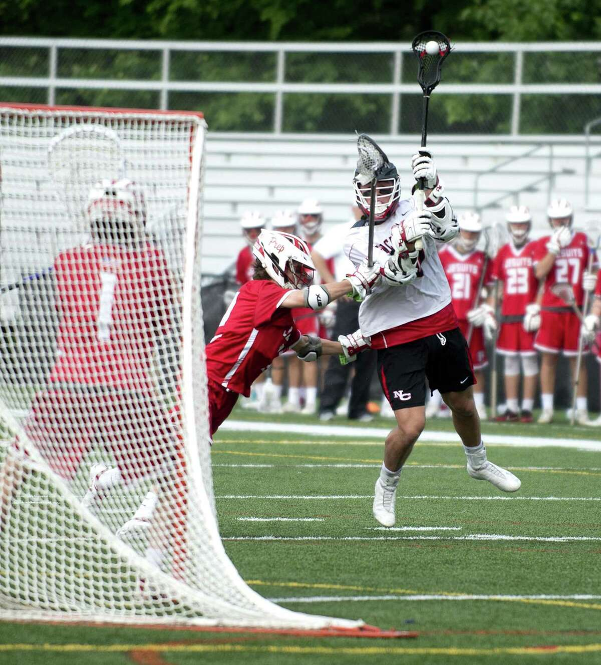 New Canaan's Quintin O'Connell scores a goal against Fairfield Prep during Saturday's Class L boys lacrosse quarterfinal game at New Canaan High School on June 2, 2018.