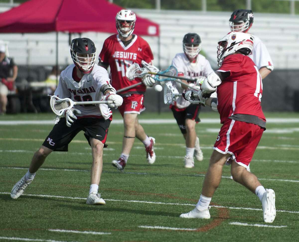 Fairfield Prep's Peter Kavanaugh scores a goal during Saturday's Class L boys lacrosse quarterfinal game at New Canaan High School on June 2, 2018.