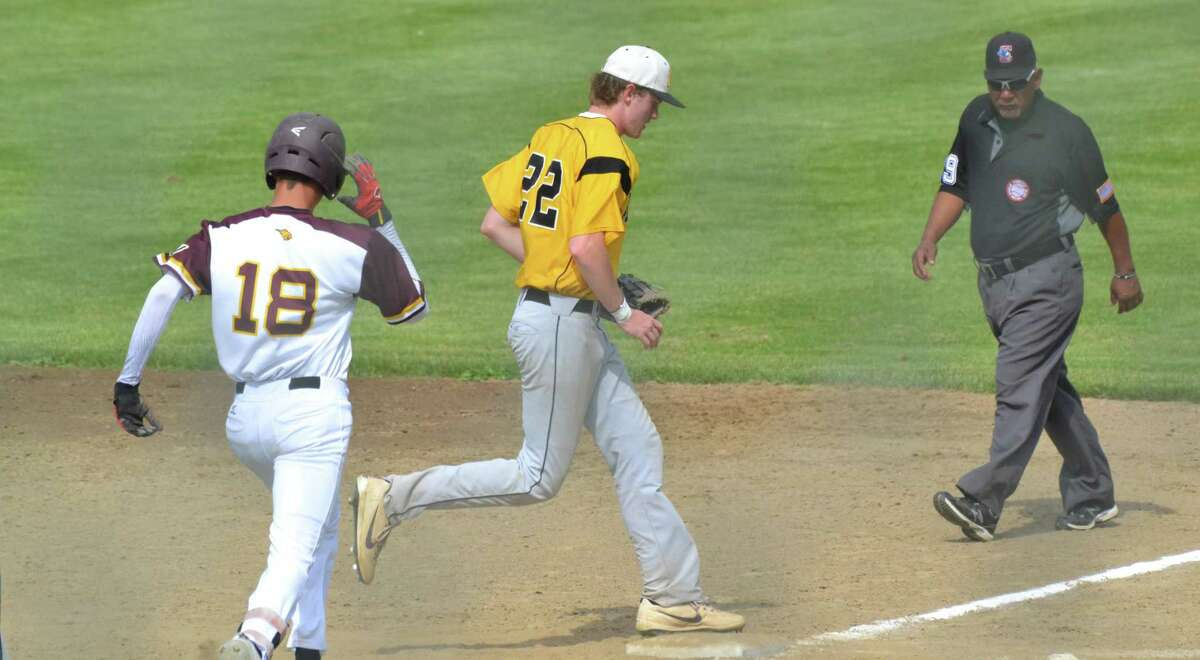 Amity's Jack Nolan steps on first base for the out against South Windsor in the Class LL quarterfinals on Saturday.