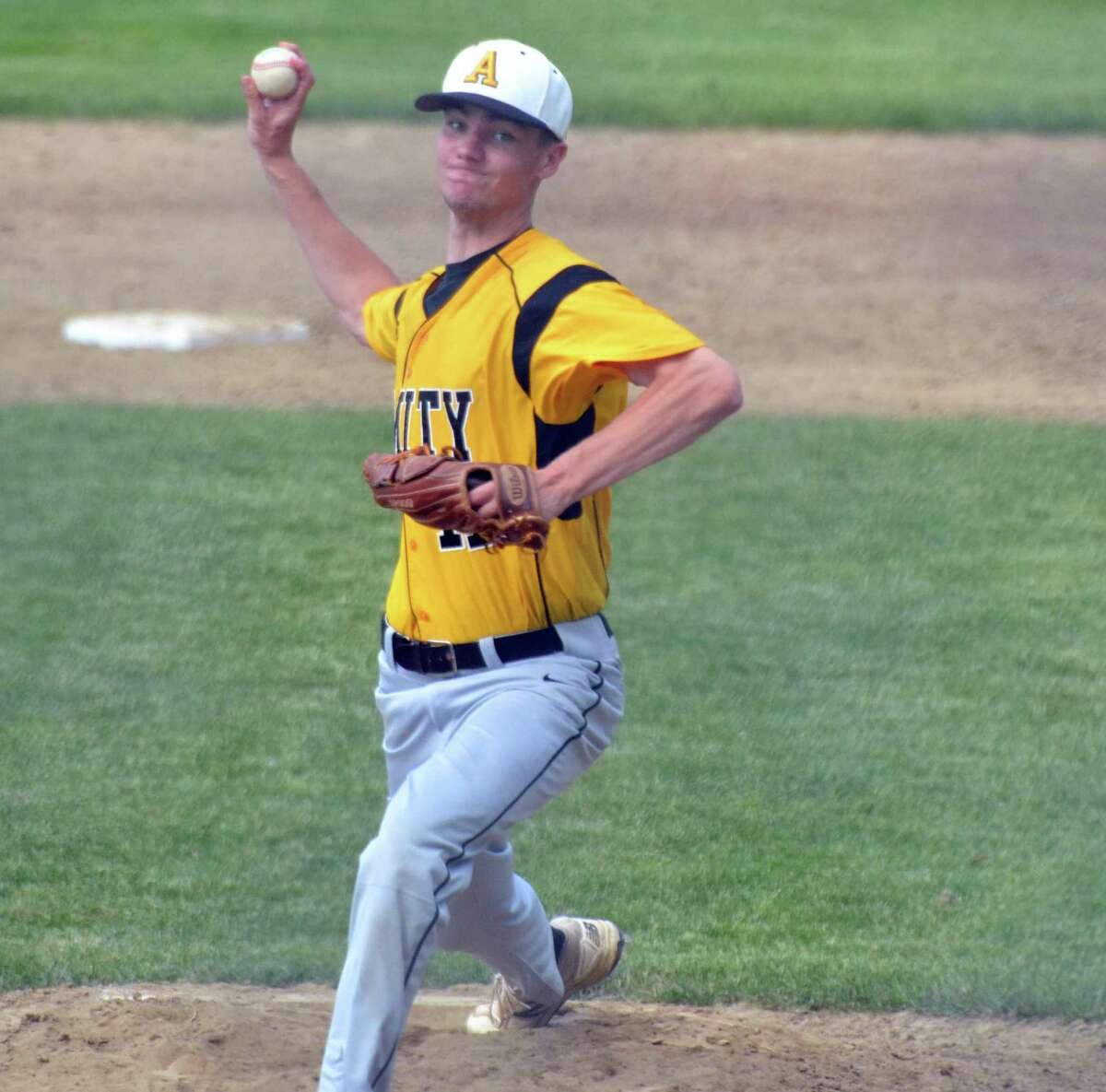 Amity's Ben Lodewick delivers a pitch against South Windsor in the Class LL quarterfinals on Saturday.
