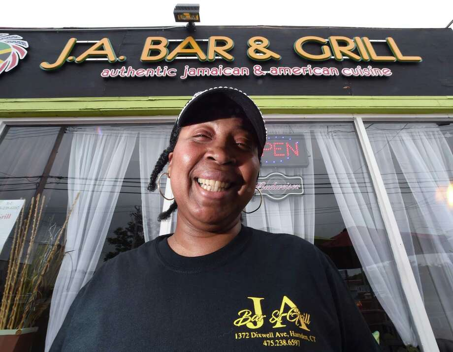 Theda Wray, co-owner of J.A. Bar & Grill, is photographed in front of the restaurant at 1372 Dixwell Ave. in Hamden on May 31, 2018. Photo: Arnold Gold / Hearst Connecticut Media / New Haven Register