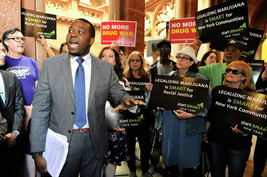 Chris Alexander, policy coordinator for Drug Policy Alliance, speaks as advocates urge New York state legislators to support the Marijuana Regulation and Taxation Act at the state Capitol, Tuesday, May 8, 2018, in Albany, N.Y. (AP Photo/Hans Pennink) Photo: Hans Pennink / FR58980 AP