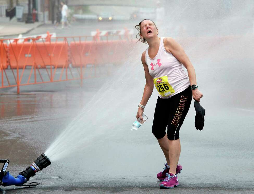 Mary Weeks of Unionville cools off after running in the 40th anniversary Freihofer's Run For Women Saturday June 2, 2018 in Albany, NY. (John Carl D'Annibale/Times Union)