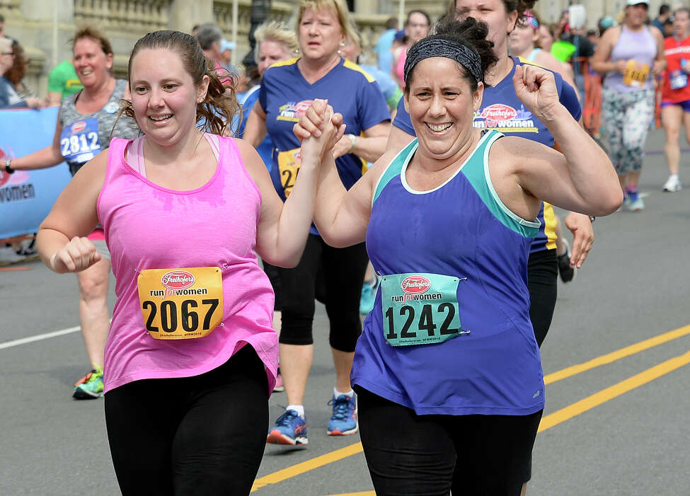 Allyson Ryder of Delmar holds hands with her mother Maryhelen Graziano as they finish the 40th anniversary Freihofer's Run For Women Saturday June 2, 2018 in Albany, NY. (John Carl D'Annibale/Times Union)