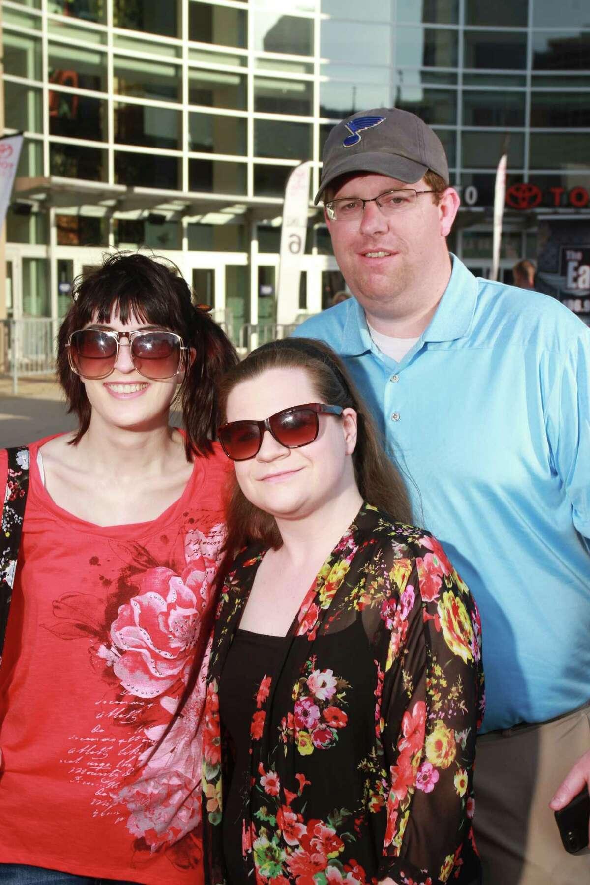 Fans attending the Paul Simon Homeward Bound tour concert at Toyota Center.