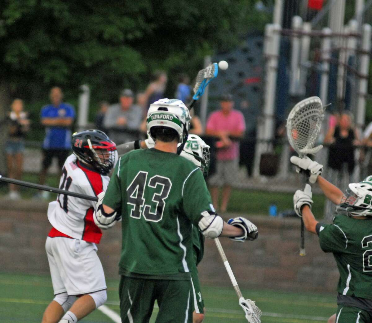 Action from New Fairfield's 13-12 win over Guilford in the Class M quarterfinals on Saturday.