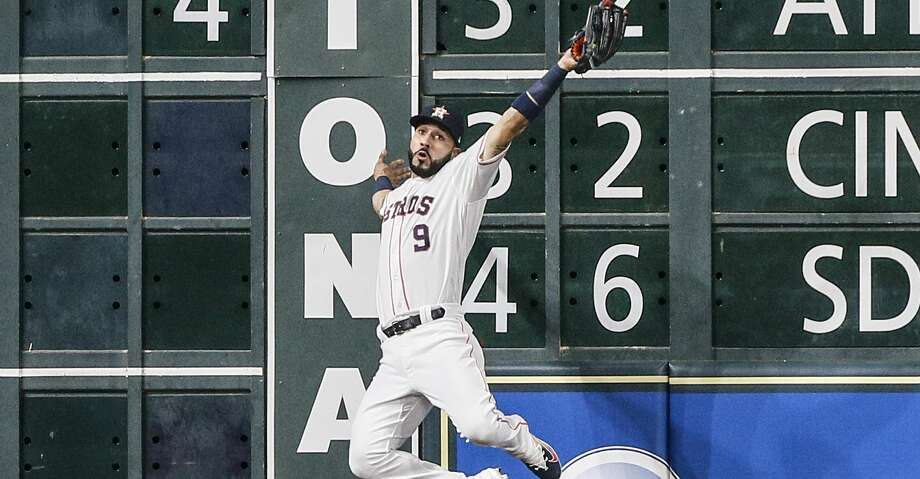 HOUSTON, TX - JUNE 02:  Marwin Gonzalez #9 of the Houston Astros makes a leaping catch at the wall on fly ball by Andrew Benintendi #16 of the Boston Red Sox in the third inning at Minute Maid Park on June 2, 2018 in Houston, Texas.  (Photo by Bob Levey/Getty Images) Photo: Bob Levey/Getty Images