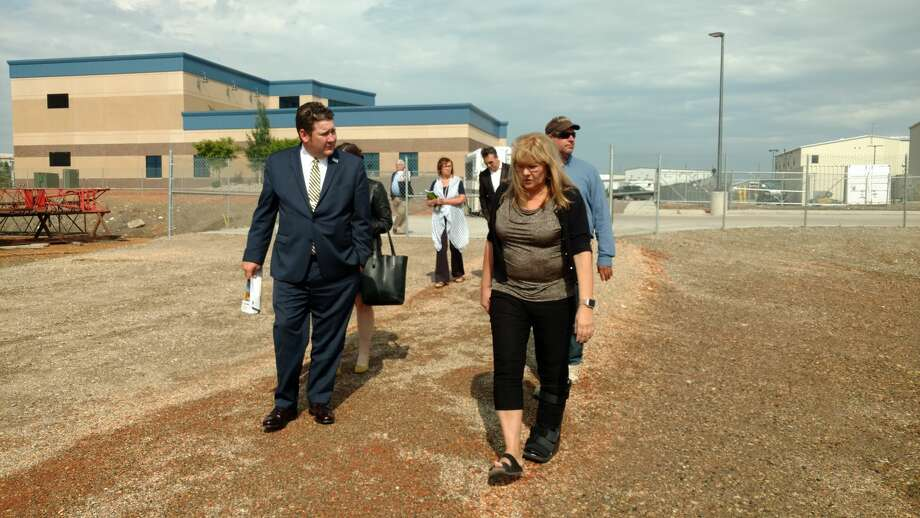 Midland City Councilman J.Ross Lacy, right, is among Midlanders who visited the Bakken last week to learn more about what Williston did to successfully handle explosive growth during the boom years. Deanette Piesik, right, led a walking tour of TrainND, which provides customized workforce training. Photo: Renée Jean/Williston Herald