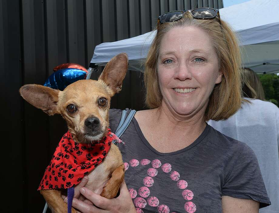 Glenn and Patti Morris were at the Dog Wash fundraiser held at Delaware Animal Clinic. The event also featured a links sale and other items to raise money to assist the Shoats family in dealing with a series of unexpected medical expenses that hit them one after another within a month. Photo taken Saturday, June 2, 2018 Kim Brent/The Enterprise Photo: Kim Brent / The Enterprise / BEN