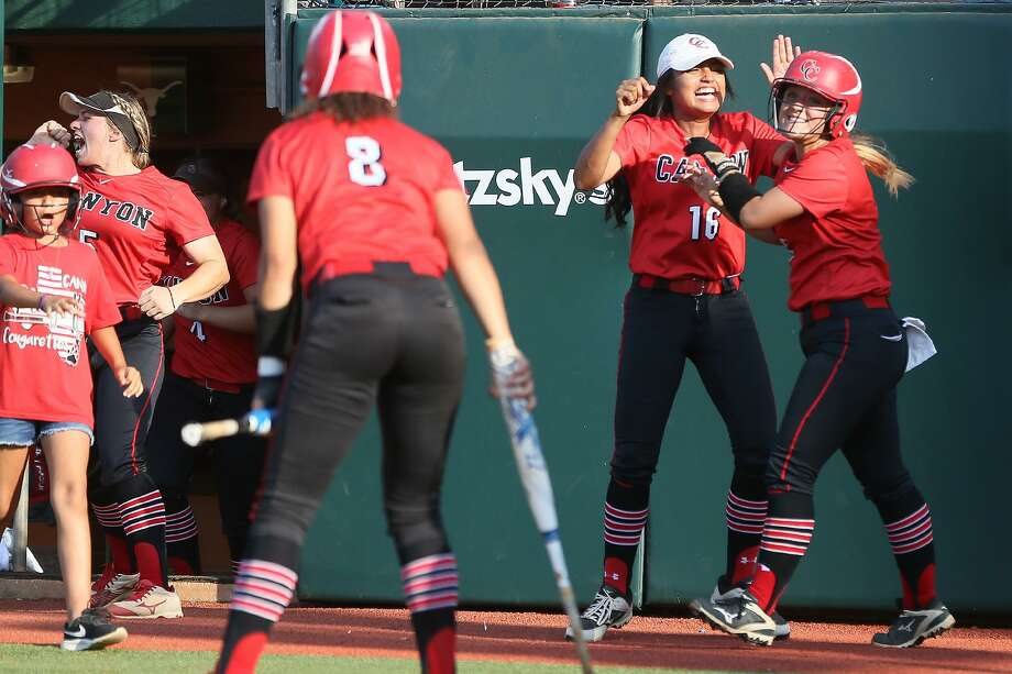 New Braunfels Canyon's Rylee Hopper (right) celebrates after scoring the Cougarettes first run of the game in the third inning during their UIL Class 6A state softball final with Humble Atascocita at McCombs Field in Austin on Saturday, June 2, 2018.  Atascocita beat Canyon 5-3.  MARVIN PFEIFFER/mpfeiffer@express-news.net Photo: Marvin Pfeiffer, Staff / San Antonio Express-News / Express-News 2018