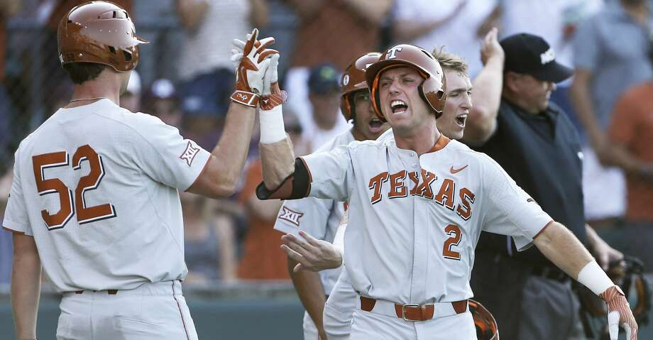 Kody Clemens celebrates after crossing home plate on his first inning home run as Texas  plays Texas A&M at Disch-Falk Field in Austin in the second round of the NCAA Regional playoffs on June 2, 2018. Photo: Tom Reel/San Antonio Express-News