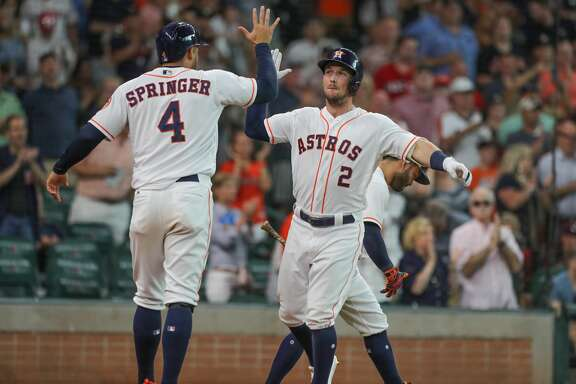 Houston Astros center fielder George Springer (4) and Houston Astros third baseman Alex Bregman (2) celebrates a 2 run homer in the 3rd inning of an MLB baseball game at Minute Maid Park Saturday, June 2, 2018, in Houston. ( Steve Gonzales / Houston Chronicle )