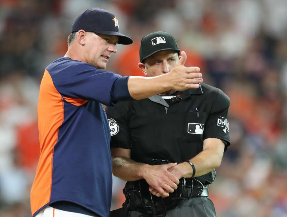 Houston Astros manager AJ Hinch (14) questions a call of complete umpire Chris Guccione during the 3 inning of an MLB baseball game at Minute Maid Park Saturday, June 2, 2018, in Houston. ( Steve Gonzales / Houston Chronicle ) Photo: Steve Gonzales/Houston Chronicle