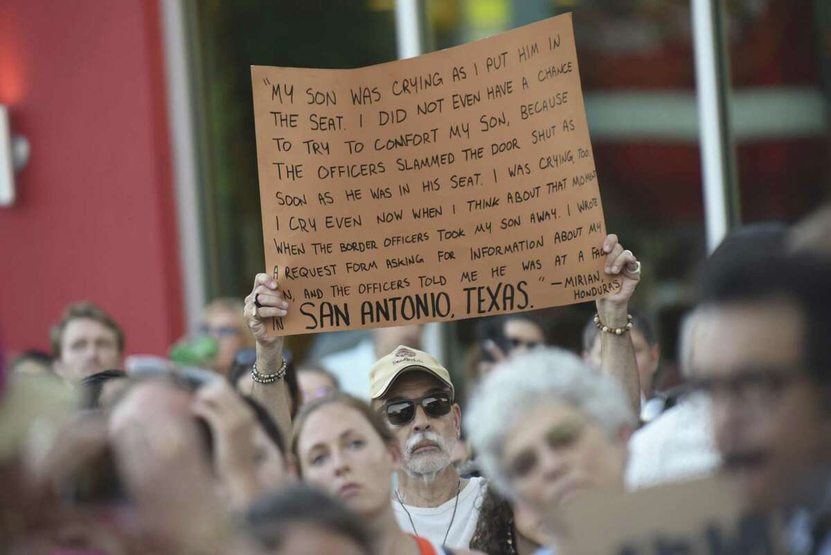 A man holds a sign demonstrates in support of immigrant children and families at the Guadalupe Cultural Center on May 31.