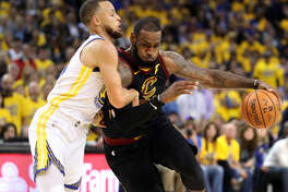 Cleveland Cavaliers' LeBron James drives on Golden State Warriors' Stephen Curry in 3rd quarter of Warriors' 124-114 win during Game 1 of the NBA Finals at Oracle Arena in Oakland, CA on Thursday, May 31, 2018. Photo by Scott Strazzante/San Francisco Chronicle