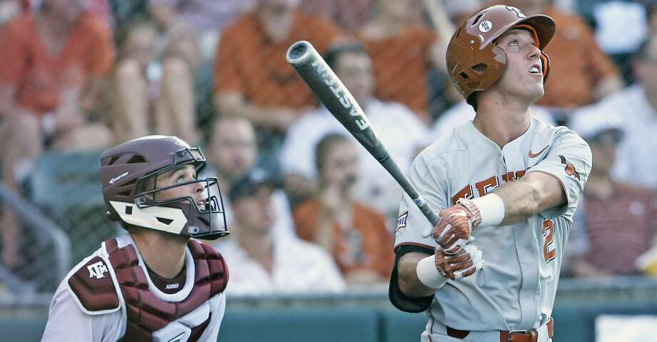 Kody Clemens watches his second homer head for the fence as Texas  plays Texas A&M at Disch-Falk Field in Austin in the second round of the NCAA Regional playoffs on June 2, 2018. Photo: Tom Reel/San Antonio Express-News