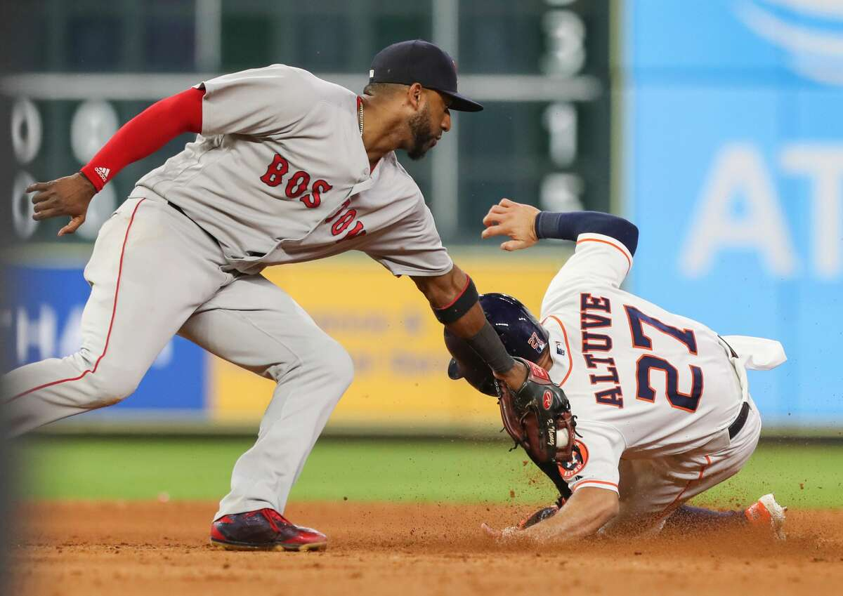 Boston Red Sox second baseman Eduardo Nunez (36) couldn't get the tag on Houston Astros second baseman Jose Altuve (27) during the 8th inning of an MLB baseball game at Minute Maid Park Saturday, June 2, 2018, in Houston. ( Steve Gonzales / Houston Chronicle )