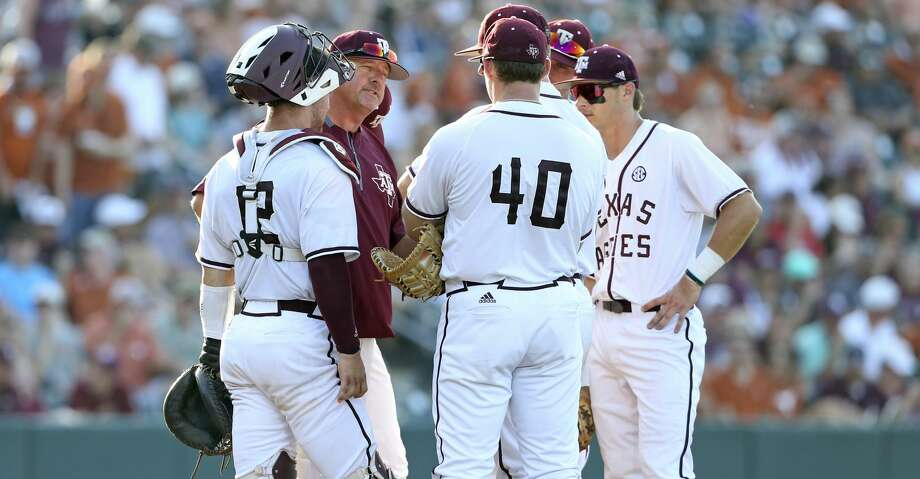 The Aggies gather on the mound after an onslaught of Longhorn hits as Texas  plays Texas A&M at Disch-Falk Field in Austin in the second round of the NCAA Regional playoffs on June 2, 2018. Photo: Tom Reel/San Antonio Express-News