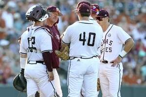 The Aggies gather on the mound after an onslaught of Longhorn hits as Texas  plays Texas A&M at Disch-Falk Field in Austin in the second round of the NCAA Regional playoffs on June 2, 2018.