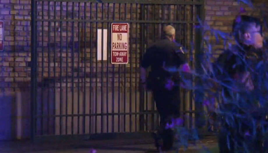 Police arrested a man with guns, ammunition and a gas mask after an hours-long SWAT standoff. Photo: Metro Video