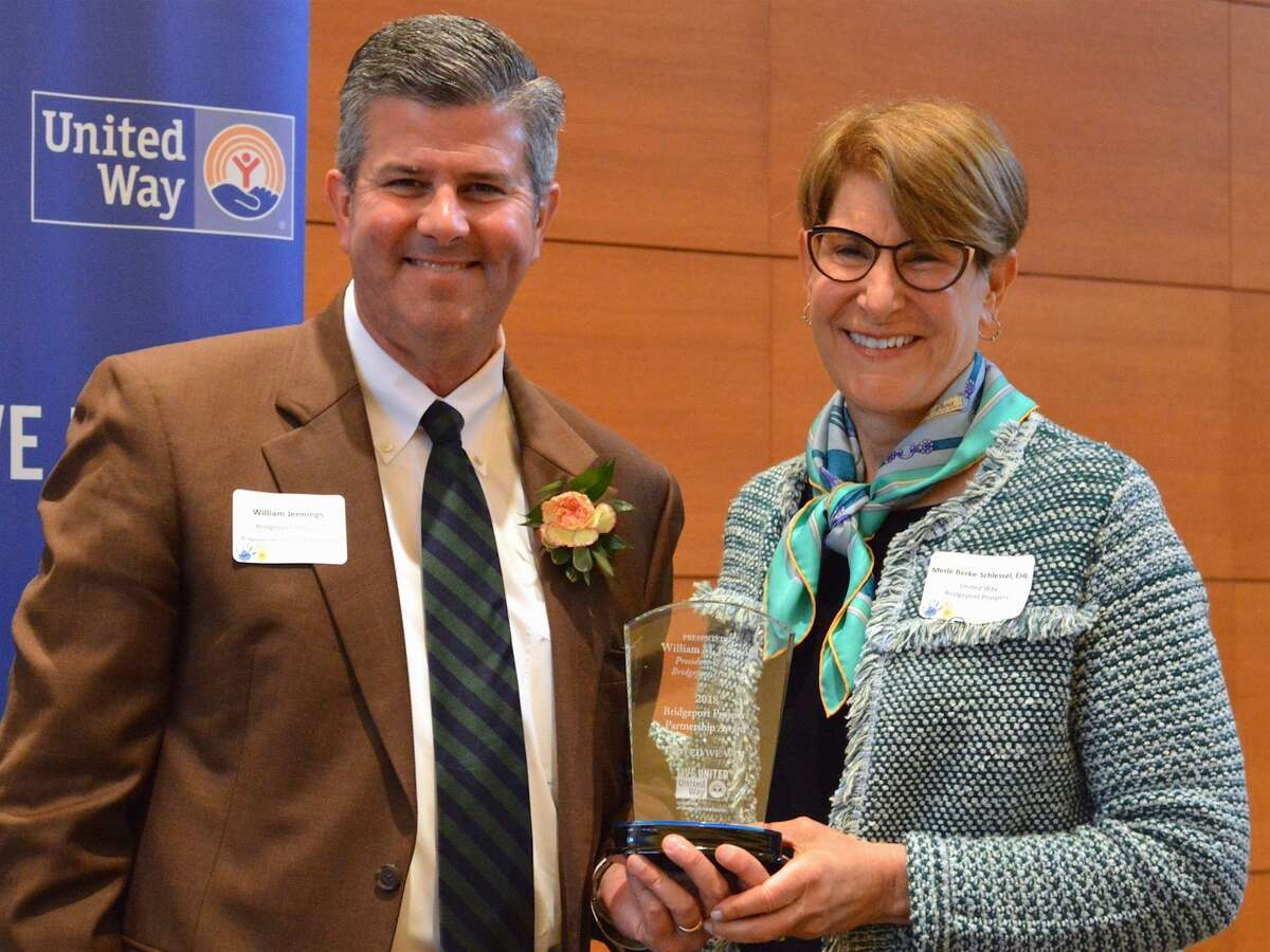 William Jennings (left) accepts the Bridgeport Prospers Partnership Award from Merle Berke-Schlessel, president and CEO of United Way of Coastal Fairfield County.