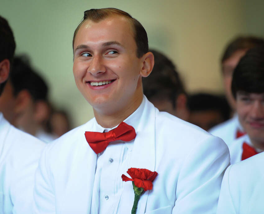 Graduate Kyle Bakonyi smiles towards family in the stands during Fairfield Prep's 76th Commencement Exercises in Fairfield, Conn. on Sunday, June 3, 2018.