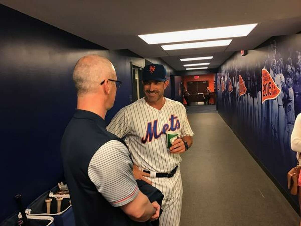 UConn coach Dan Hurley, left, chats with Mets manager Mickey Callaway prior to Sunday's game at Citi Field. Hurley threw out the ceremonial first pitch.
