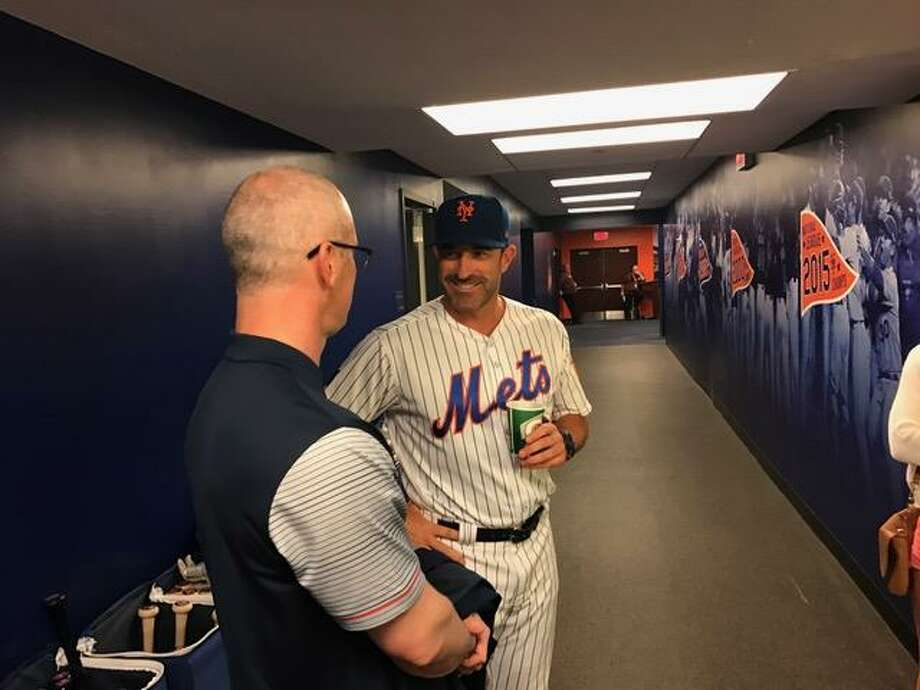 UConn coach Dan Hurley, left, chats with Mets manager Mickey Callaway prior to Sunday's game at Citi Field. Hurley threw out the ceremonial first pitch. Photo: David Borges / Hearst Connecticut Media