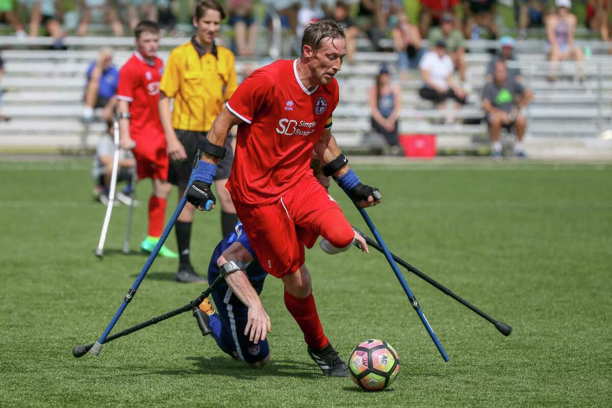 June 2, 2018: Team England Ray Westbrook keeps his balance during the Amputee Soccer Lone Star Invitational match between the England Amputee Soccer Team and USA Amputee Soccer Team at Gosling Sports Fields in The Woodlands, Texas. (Leslie Plaza Johnson/Freelance)