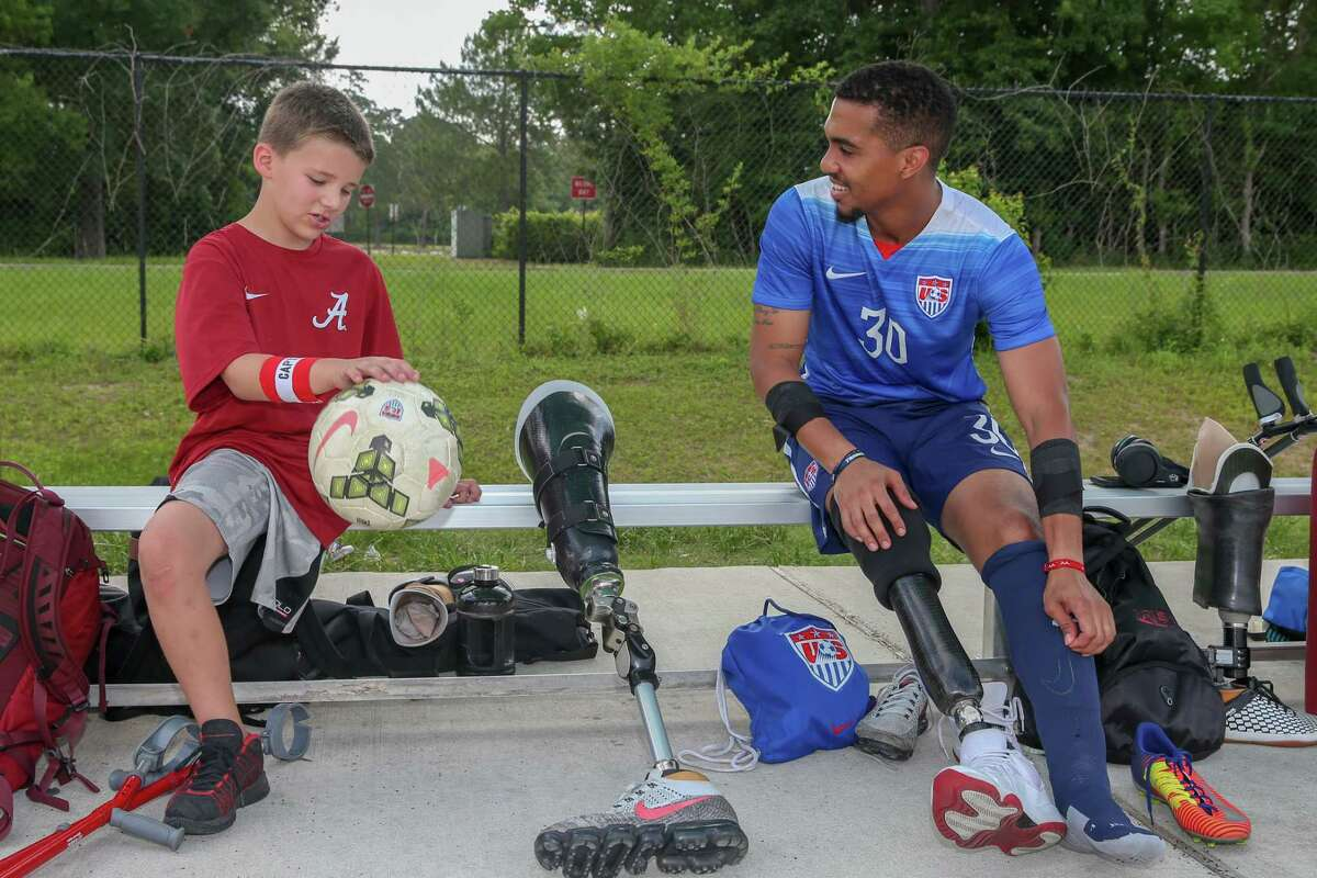 June 2, 2018: Cooper Andrew chats with Team USA Robert Anthony Rodriguez during the Amputee Soccer Lone Star Invitational match between the England Amputee Soccer Team and USA Amputee Soccer Team at Gosling Sports Fields in The Woodlands, Texas. (Leslie Plaza Johnson/Freelance)